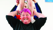 Betsy Mitchell Henning, of Laurel, balances her son Ian, 7, on her shoulders.