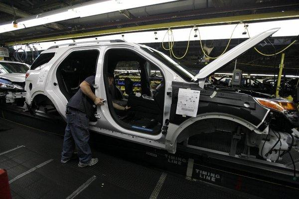 Ford workers build an Explorer SUV at the automaker's Chicago Assembly Plantin 2010.