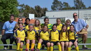 The Newport-Mesa girls' U10 Yellow Tigers soccer team won the Spring AYSO Regions 57, 97 and 120 Tournament Championship on Sunday.