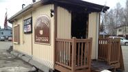 Anchorage firefighters are investigating a fire at a Midtown coffee stand early Tuesday morning, this month's second suspicious blaze at a local food-service establishment with indications of burglary beforehand.