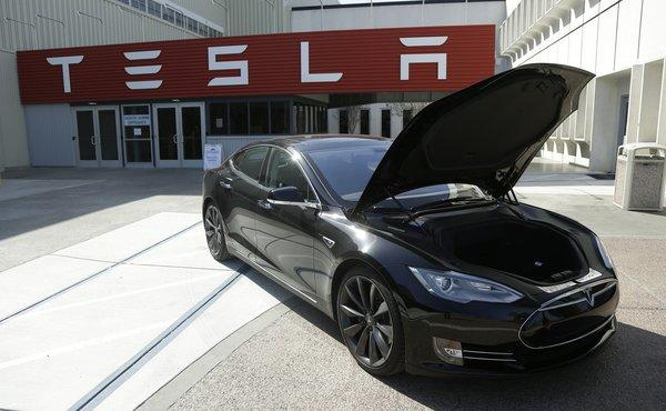 Tesla Motors used money from stock and debt offering deals to fully pay off a Department of Energy loan.