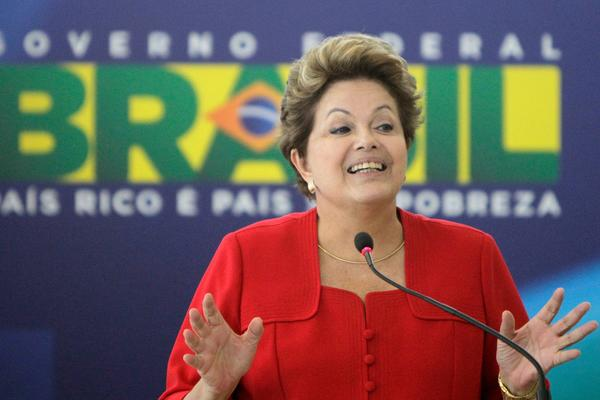 Brazilian President Dilma Rousseff reaffirmed the government's commitment to an antipoverty program whose rumored discontinuation had sparked a run on banks.