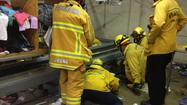 Pasadena firefighters rescued a man whose arm became stuck in a conveyor belt Wednesday morning at the Salvation Army warehouse on Waverly Drive.