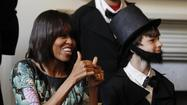WASHINGTON -- First lady Michelle Obama, whose great-great-great maternal grandmother was a slave, made a short trip from the White House on Wednesday to the nearby Decatur House, touring the historic former home and its adjacent slave quarters.