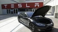 Upstart electric car maker Tesla Motors on Wednesday paid off a Department Energy loan that had become a political hot potato.