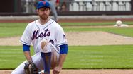 New York Mets Ike Davis watches double past him by Cincinnati Reds Brandon Phillips driving in winning run in MLB game in New York