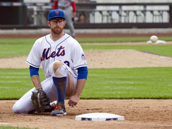 Mets first baseman Ike Davis watches the ball that he thought was going foul.