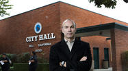 The city manager of Bell called unfair a state report critical of the town's progress after a massive corruption scandal.