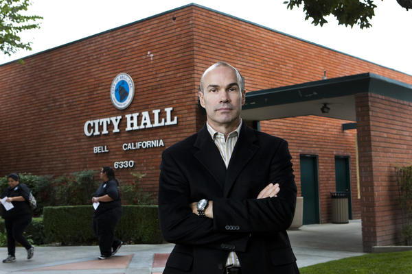 Bell city manager Doug Willmore, shown outside City Hall in January, works in the office occupied by his predecessor, Robert Rizzo.