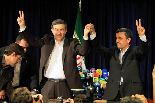 Iranian President Mahmoud Ahmadinejad, right, with Esfandiar Rahim Mashaei after the top aide signed up to be a presidential candidate.