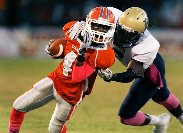 Mount Dora wide receiver Jonta Scott runs after a catch during the Eustis High School at Mount Dora High School football game on Friday, October 12, 2012.