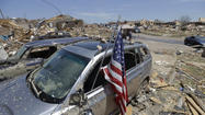 MOORE, Okla. --  After closing shattered neighborhoods to traffic in the aftermath of Monday's massive tornado, city officials allowed residents with proper IDs to drive to what remained of their homes Wednesday to retrieve belongings.