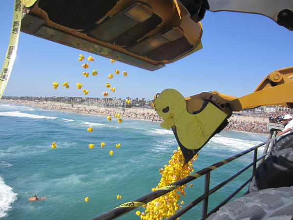 Thousands of rubber ducks are dumped into the ocean off the Huntington Beach Pier on Saturday.