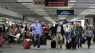 Travelers make their way around Fort Lauderdale-Hollywood International Airport in March.