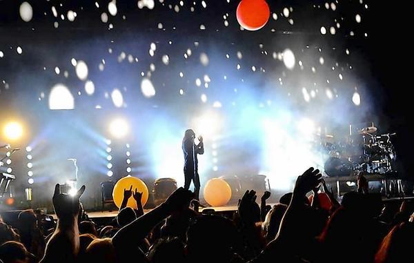 Thirty Seconds to Mars performs in front of a colorful backdrop at the 2013 KROQ Weenie Roast at the Verizon Wireless Amphitheatre on Saturday.