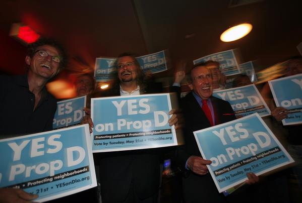 """Yes on D"" campaign members celebrate after absentee vote count numbers put the measure ahead 64% as they gathered to watch returns at Lucky Strike Lanes on Hollywood Boulevard on election day."
