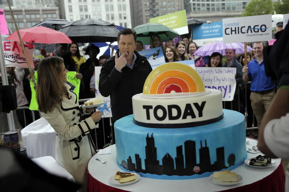 Today Show hosts Natalie Morales and Willie Geist taste a specialty cheesecake from Eli's Cheesecake during the broadcast of a segment from Millennium Park Wednesday.