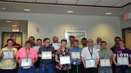 More than a dozen Somerset County Workshop clients who helped with the county recycling program were recognized this week by the commissioners with certificates and warm words.