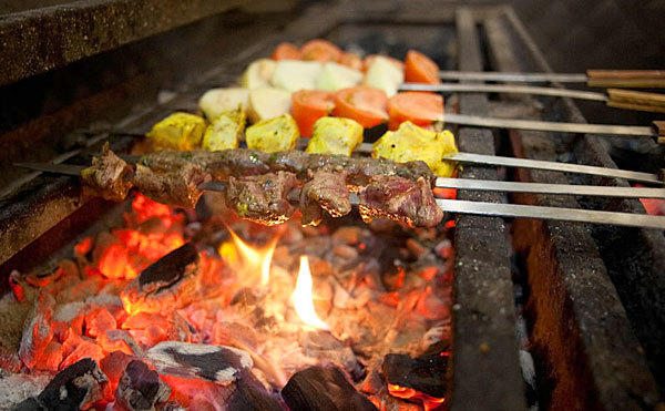 Fire and meat: Lamb and chicken and mixed beef are prepared at Almawal, a Middle Eastern restaurant in Worth.