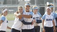 Marina High pitcher Tera Blanco, center, and teammate Alyssa Sojka, second from left, celebrate after defeating Roosevelt of Corona in a first-round CIF Southern Section Division 1 playoff game at Marina on Thursday.