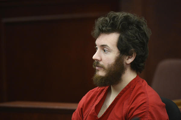 James Holmes sits in the courtroom during his arraignment in Centennial, Colo., on March 12. His trial is expected to begin in February 2014.