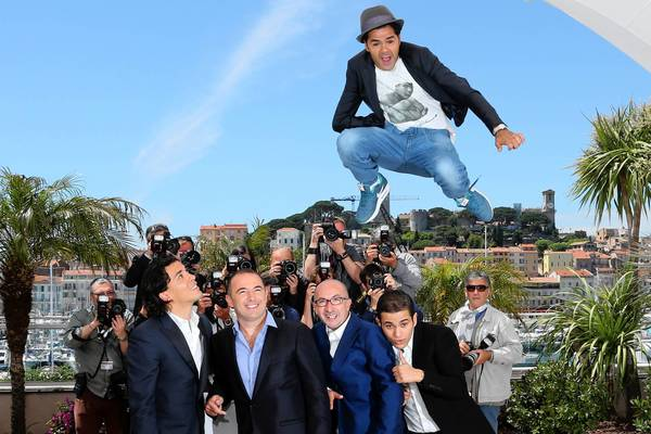 "French actor Jamel Debbouze, top, jumps above  actor Tewfik Jallab, left, director Mohamed Hamidi, French-Algerian actor Fatsah Bouyahmed and French comedian Malik Bentalha during a photocall for the film ""Ne Quelque Part"" (Born Somewhere) at the Cannes Film Festival."