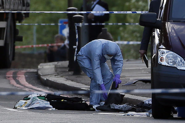 A police forensics officer investigates a crime scene where a British soldier was killed in an apparent terrorist attack.