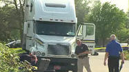 A 43-year-old truck driver who was shot by a Merrillville police officer he was beating in a Planned Parenthood parking lot this week has been charged.