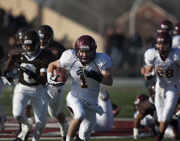 Montini wide receiver Joseph Borsellino gains a first down against Joliet Catholic at Memorial Stadium in Joliet, Ill., on Saturday, Nov. 17, 2012.