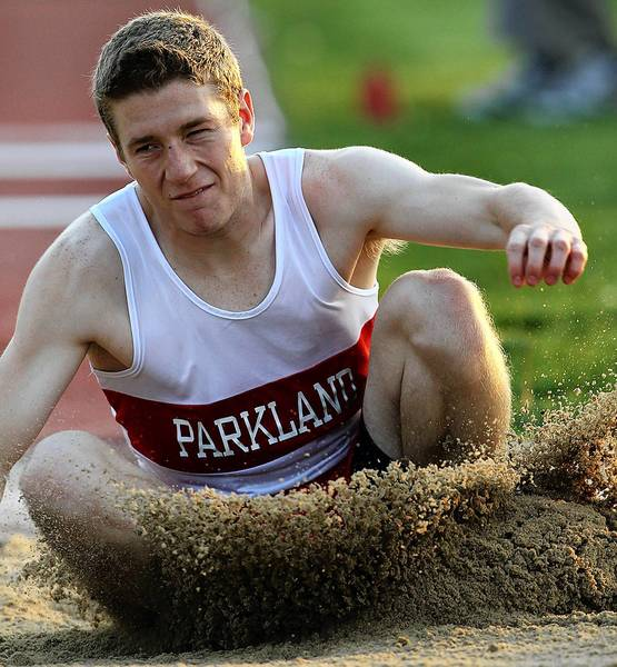 Parkland's Nolan Hay, makes a hard landing in the boys AAA triple jump, during the District 11 Track and Field Championships at Blue Mountain High School in Schuylkill Haven Wednesday May 15, 2013.