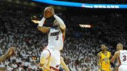 Heat guard Dwyane Wade pulls up for a running floater Wednesday against the Pacers. (Joe Cavaretta, Sun Sentinel)