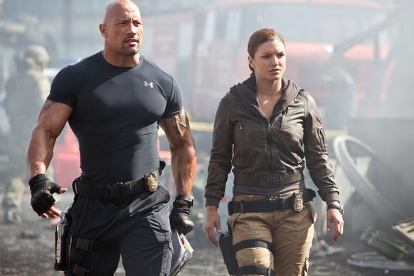 "Hobbs (Dwayne Johnson) and Riley (Gina Carano) lead their strike team in ""Fast & Furious 6."""