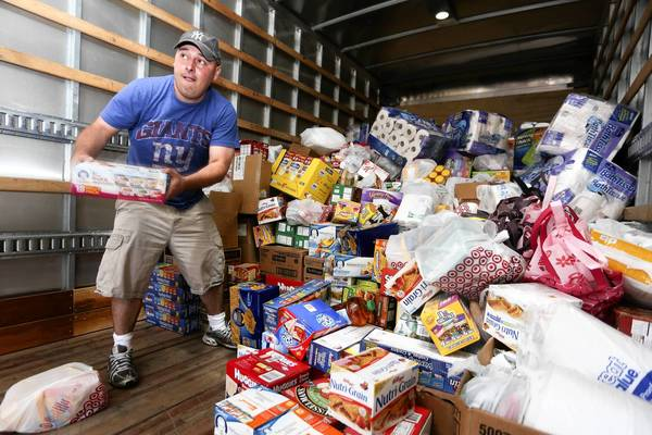Pastor Roger Murphy of OKC Faith Church in Oklahoma City unloads donated goods to be distributed to victims of the tornado in nearby Moore.