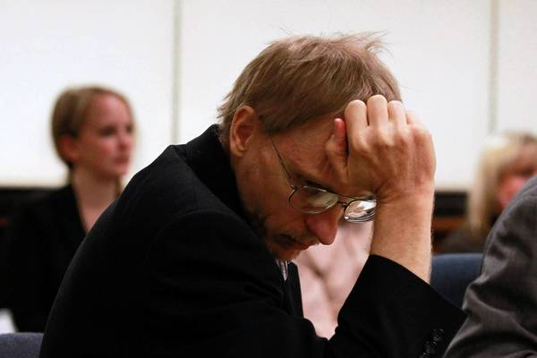 Ronald Stolberg reacts as Dr. Manny Montez, a forensic pathologist, goes over the details of the autopsy he performed on Stolberg's wife, Rachel Stolberg, in 2011. Stolberg is on trial for the murder of his wife in the courtroom of Judge Mark Levitt in Lake County, Waukegan.