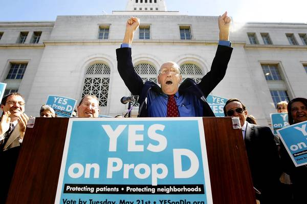 Patients and supporters of Proposition D, including Los Angeles City Councilman Bill Rosendahl, center, appear at a rally at City Hall in downtown L.A. last month. Voters approved the measure Tuesday.