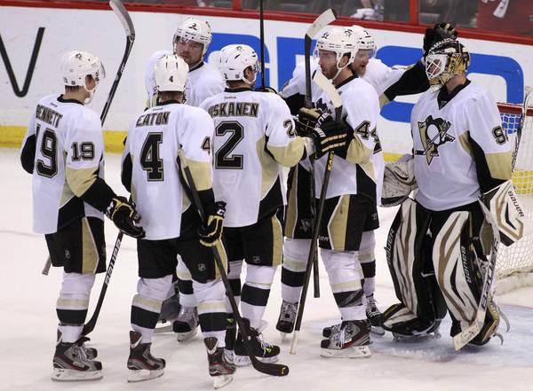 Penguins goalie Tomas Vokoun is congratulated by teammates after the Game 4 win.