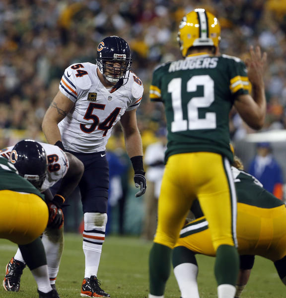 Brian Urlacher eyes Packers quarterback Aaron Rodgers in the fourth quarter.
