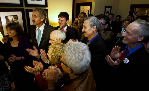 City attorney-elect Mike Feuer speaks with friends, family and supporters just before midnight at his election night party.