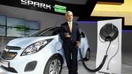 DETROIT (Reuters) - The Chevrolet Spark all-electric subcompact car will cost U.S. buyers as much as 38 percent less than what it takes to buy its larger sibling, the hybrid Volt, General Motors Co said on Thursday.