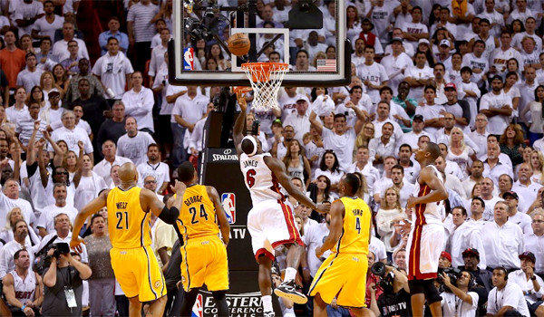 LeBron James scores the game-winning layup as the clock expires in overtime giving the Miami Heat a 103-102 victory over the Indiana Pacers in Game 1 of the Eastern Conference finals.