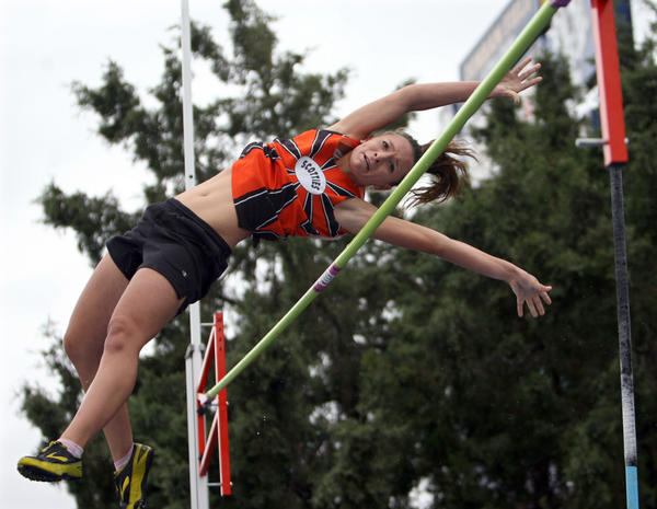 Ariana Arampatzis clears the bar during the pole vault while competing for Philip at the state meet in Rapid City last season. Arampatzis is back at Aberdeen Central and has overcome an injury to move into the Class AA leaders in the pole vault with a performance of 10 feet.