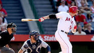 Josh Hamilton stood alone in the far corner of the Angels' clubhouse early Wednesday evening, looking far too frustrated for a guy whose batting average is higher than it has been in nearly a month and whose team is on its longest winning streak in nearly a year.