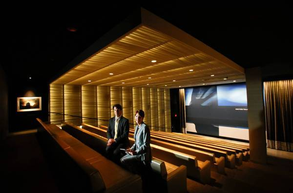 United Talent Agency has held 275 screenings at its private theater since the company's new Beverly Hills headquarters opened in September. Above, David Lapeze, UTA's chief technology officer, and Lisa Perrine, CEO of audio-visual consultant Cibola Systems, inside the screening room in April.