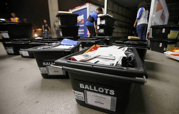 Workers at the Los Angeles City Elections Division Services Center unload boxes of ballots and polling station supplies from trucks at the Piper Tech Building in downtown Los Angeles on Wednesday.