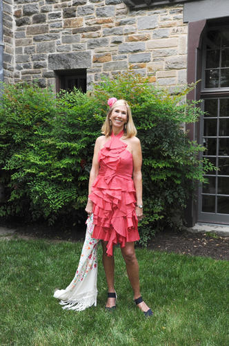 "Jennifer Snouffer, 57, was cha-cha-cha-charming in the outfit she wore to Chuck and Mary Kay Nabit's Preakness party, which had a ""vintage Havana"" theme. That theme also helped the Roland Park resident with her current fashion goals. ""I'm trying to shift my style from very tailored to something softer and more feminine,"" she said. The Wells Fargo Advisors investment advisor started with a coral linen Robert Rodriguez ruffled halter dress and embroidered white piano shawl, both of which she bought a while back at Ruth Shaw. She added crystal embellished gold filigree earrings she found at Jane & Georgie in Rehoboth Beach  and black canvas wedge Andre Assous espadrilles from a boutique in Vero Beach, Florida. Her Raymond Weil watch was a Radcliffe Jewelers purchase. And that begonia? It came from her garden."