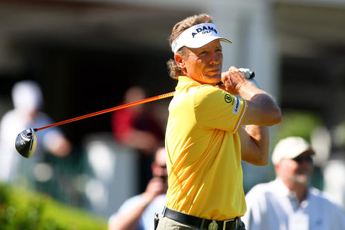 Bernhard Langer follows through on his tee shot on the 1st hole during practice day for the 74th Senior PGA Championship.