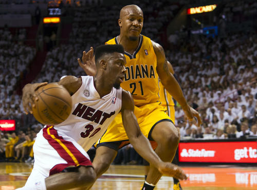 Miami Heat point guard Norris Cole (30) drivers to the basket as Indiana Pacers power forward David West (21) defends during the second half in game one of the Eastern Conference finals of the 2013 NBA Playoffs at American Airlines Arena. Miami wins in overtime 103-102.