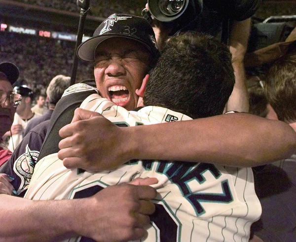 World Series Game 7 Florida Marlins vs Cleveland Indians at Pro Player Stadium. Livan Hernandez and Alex Fernandez share a celebration hug after they won the world series.
