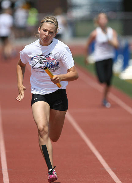 Sierra Stotz, of Tolstoy, runs the anchor leg in the girls 400 meter relay at the USATF Junior Olympic track meet at Swisher Field in 2012.