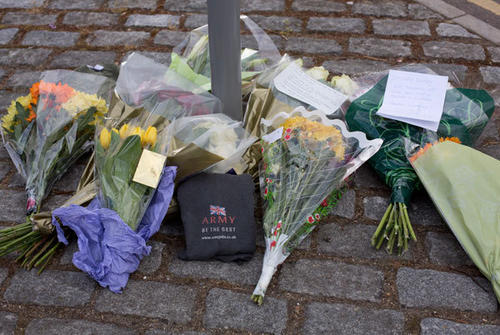 Floral tributes are seen outside the Royal Military Barracks, near the scene where a British soldier was killed in Woolwich, southeast London May 23, 2013. The soldier was hacked to death on Wednesday by two men shouting Islamic slogans in a south London street, in what Prime Minister David Cameron said appeared to be a terrorist attack.